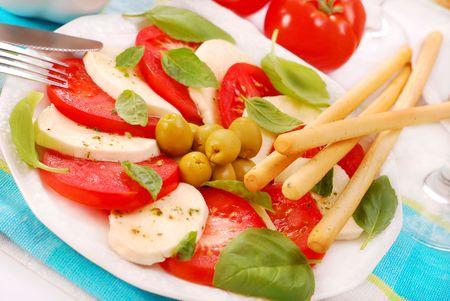 grissini: caprese salad with mozzarella,tomato,basil and grissini Stock Photo