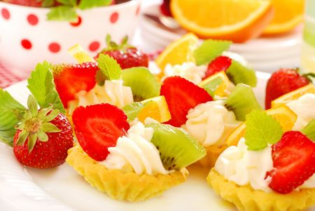 mini tartlets with whipped cream and fresh fruits photo