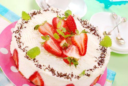 round cheesecake with fresh strawberries photo