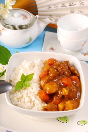 japanese curry rice with meat,carrot,onion and potato photo