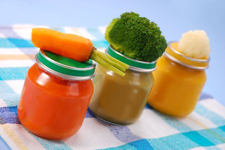 three jars of vegetables puree as baby food  photo