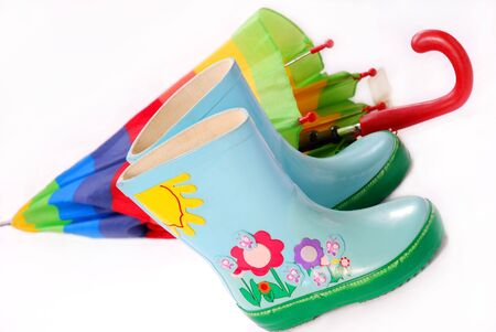 children`s wellington boots and umbrella for rainy day,isolated on white Stock Photo - 7433301