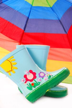 children`s wellington boots and umbrella for rainy day,isolated on white Stock Photo - 7433302