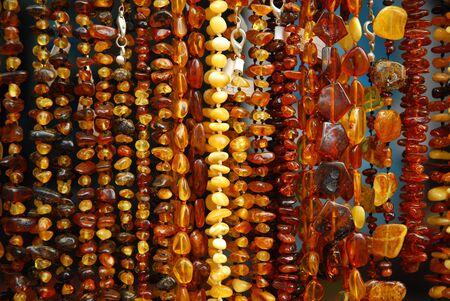 various polish amber necklases hanging at exhibition photo