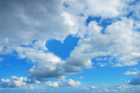 cloudy sky with heart shape blue  hole Stock Photo