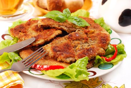 plate with breaded parasol mushrooms (kania) popular in Poland