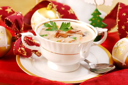 traditional polish mushroom soup with cream for christmas in white elegance dishware photo