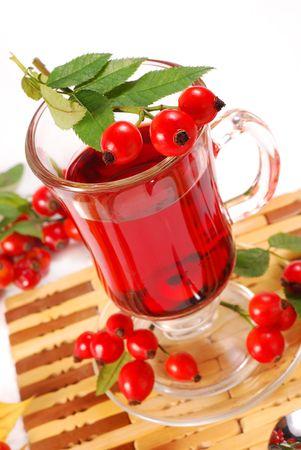 glass of fresh herbal rose hip tea photo