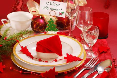 decoration of christmas table in red and white colors photo