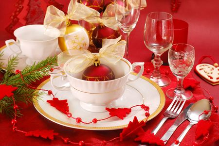 crockery: decoration of christmas table in red and white colors