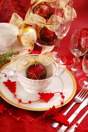 christmas dish: decoration of christmas table in red and white colors