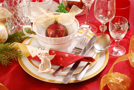 decoration of christmas table with angel in  white and red colors photo