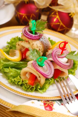 party food: rolled herring fillets with paprika and onion for christmas