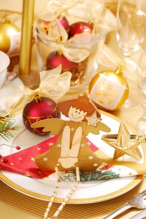 christmas table decoration with wooden angel on plate in golden and white colors Stock Photo - 8167489