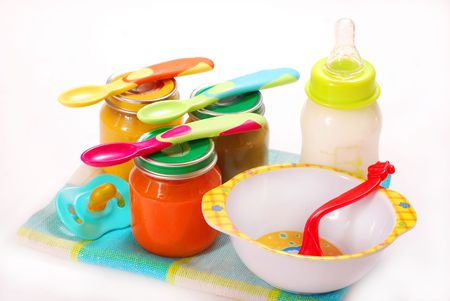 pap: jars of various baby food and bottle of milk