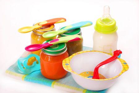 jars of various baby food and bottle of milk