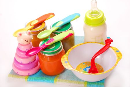 jars of various baby food and bottle of milk photo