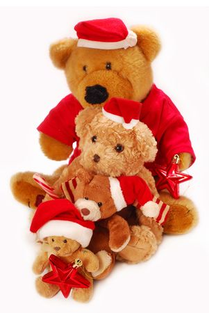 four various size  teddy bears in red  santa claus hats isolated on white photo