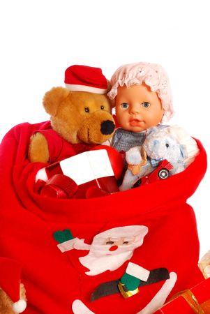 santa`s red sack full of gift for children isolated on white