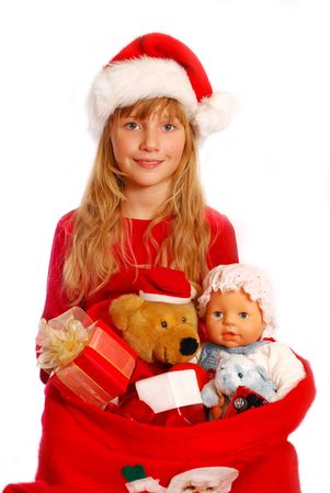 young girl with santa `s  sack full of christmas gift for children isolated on white photo