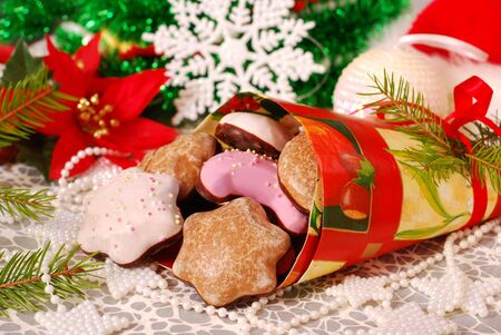 colorful gingerbreads with icing and topping in paper cone for christmas photo