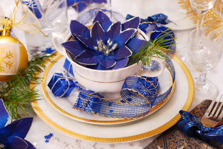 elegance christmas table decoration in white,blue and golden colors photo