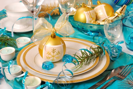 elegance christmas table decoration in turquoise,white and golden colors photo