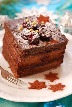 christmas gingerbread cake with chocolate cream and cherry