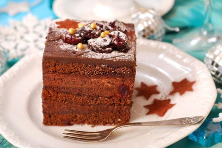 christmas gingerbread cake with chocolate cream and cherry photo