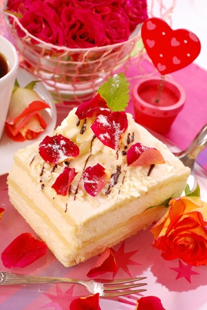 almond cake with rose petals decoration for valentine`s party photo