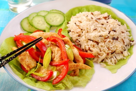 oriental deep fried chicken with vegetables and wild rice photo