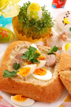 white borscht with eggs and sausage in bread bowl for easter photo