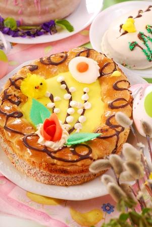 traditional polish easter cakes (mazurek,babka ) on festive table photo
