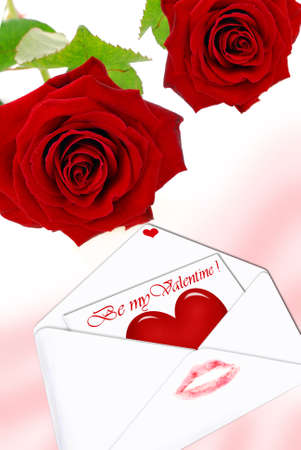 two red roses and white opened  envelope with love letter inside photo