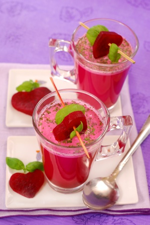 beet soup with cream (  red borscht ) in glass decorated with heart shaped slices Stockfoto