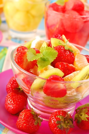 colorful fruit salad in bowl for summer party photo