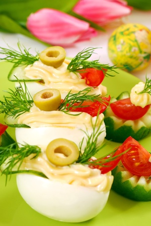 eggs with  mayonnaise and olives as appetizer for easter