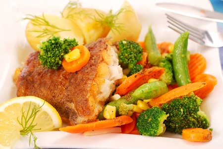 fried halibut fish with vegetables and potato for dinner photo
