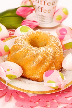 lemon ring cake with icing sugar on easter table photo
