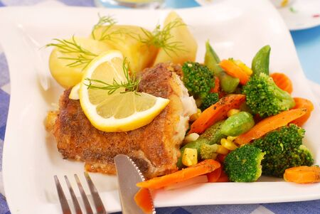halibut: fried halibut fish with vegetables and potato for dinner