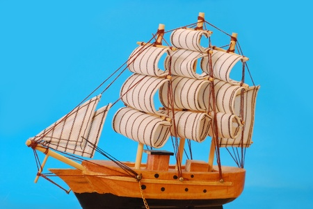 model of vintage tall sailing ship against blue background photo