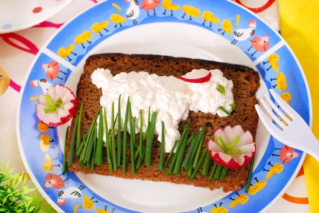 funny easter breakfast with lamb shape on sandwich for child photo