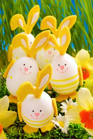 easter decoration with many eggs in bunny shape standing in grass  photo