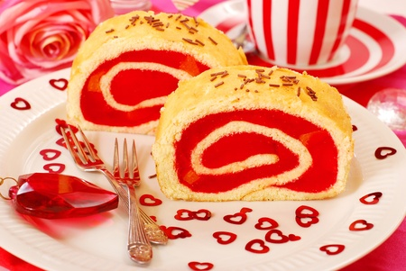two slices of strawberry jelly swiss roll for valentine`s party photo