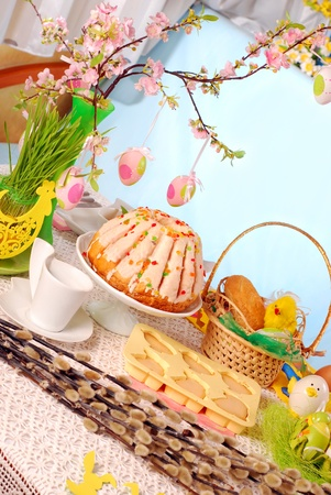 easter table decoration with ring cake,cookies and basket photo
