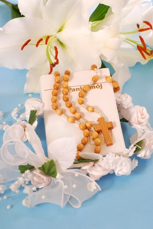 prayer book and wooden rosary for first holy communion on blue background Stock Photo - 9269289