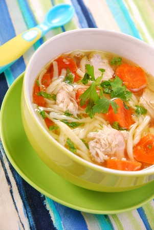 polish chicken: bowl of clear chicken soup with noodle and vegetables for child