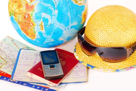 overseas visa: concept of traveling all over the world with mobile phone,passport,money,map and globe isolated on white