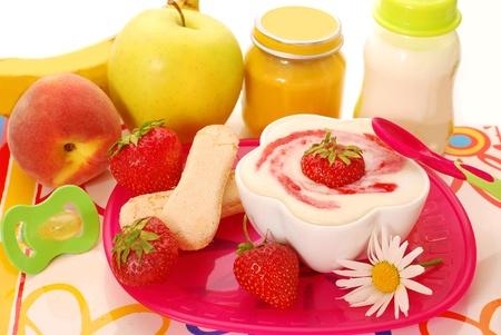 porridge: semolina porridge dessert with  strawberries  ,fruits and other food for baby
