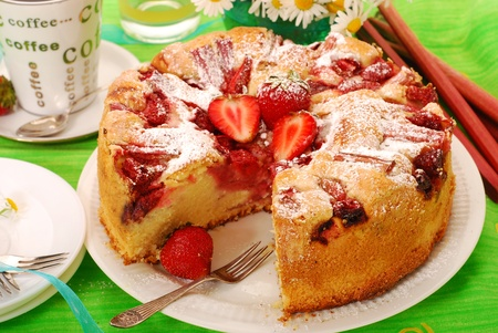 sponge cake: homemade cake with strawberries  and rhubarb on the table